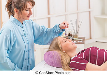 Therapist using pendulum