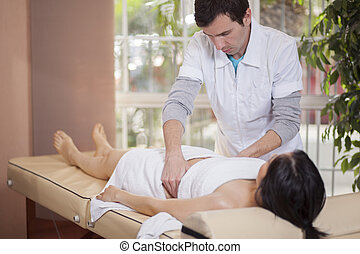 Therapist working at a spa