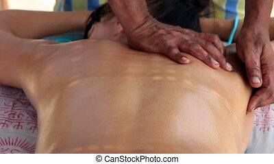 therapists hands doing back massage