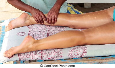 therapists hands doing legs massage