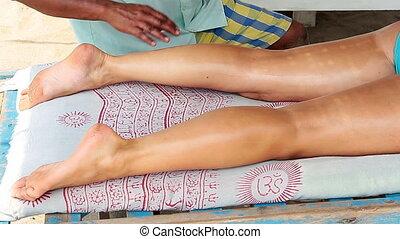 therapists hands doing legs massage