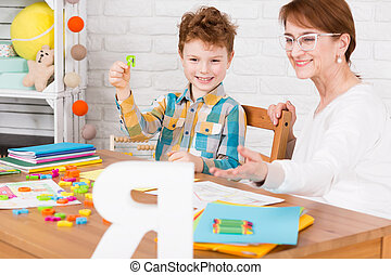 Therapy helpful in child education - Yooung boy and his...