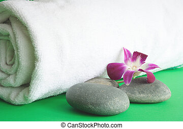 therapy - Pebbles and towel in green background