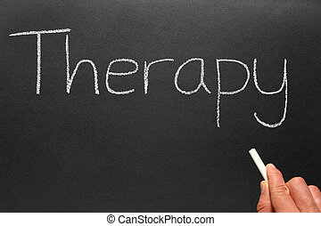Therapy, written on a blackboard.