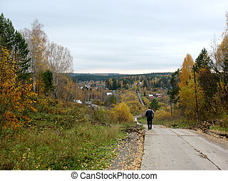 autumn trees, road and man silhouette - There are blue sky, ...