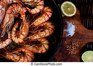 There are shrimps in a cast iron skillet - Prawns fried and ...