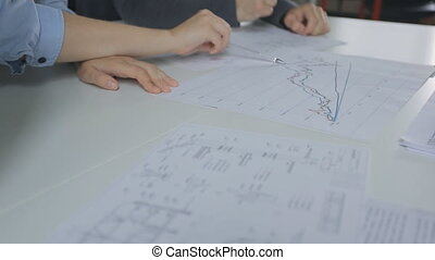There is close-up image of people discussing graphics