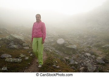 There is one girl in the fog