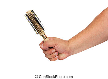 Thermal hairbrush in the hand isolated on white background