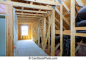 Thermal insulation in process of construction frame attic house newly constructed home
