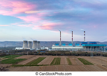 thermal power plant in sunset
