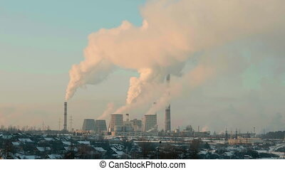 Thermal power plant in the evening. Real time middle shot