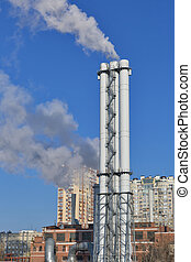 Thermal power plant with a smoke against city landscape