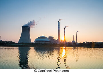 thermal power plant with the setting sun