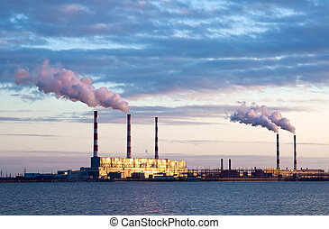 power station - Thermal power station and smoke plume lit...