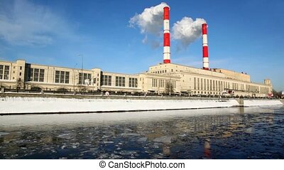 Thermal power station on Moscow River, pipes and smoke, air...