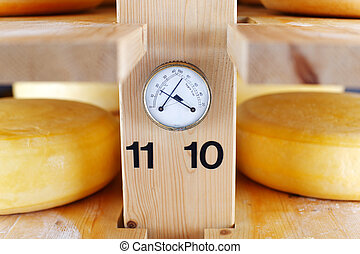 Thermometer and Hygrometer in a cheese cellar, allowing for correct temperature and humidity during the maturation of the cheese