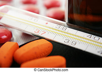 thermometer and medication - Thermometer with medication....