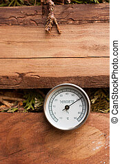 Thermometer in the compost pile 03