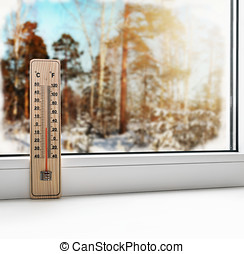 Thermometer on a frozen window and cold weather