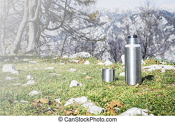 Thermos on green grass.