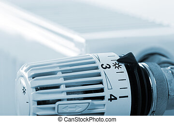 Closeup of heating radiator thermostat. Toned in blue