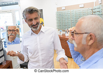 they are checking the eyeglasses