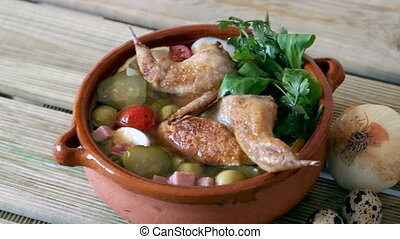 Thick and spicy solyanka with quails, ham, olives, eggs and ...