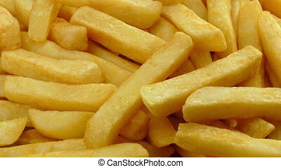 Thick Cut Potato Fries Closeup - Closeup of thick-cut potato...