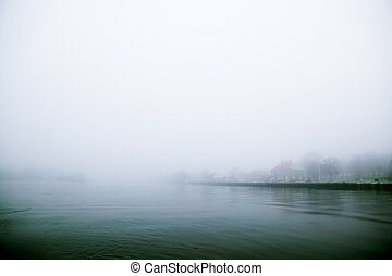 Thick Fog over Water - A river edge in thick fog during the...
