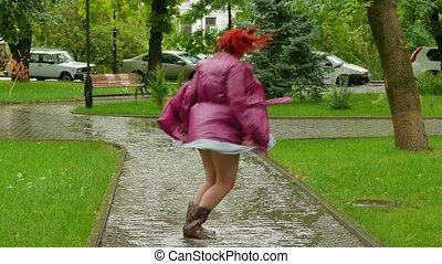 Thick girl jumping in a puddle - Oily red-haired girl...