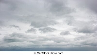 Thick Gray Clouds Drifting across the Sky in Timelapse - ...