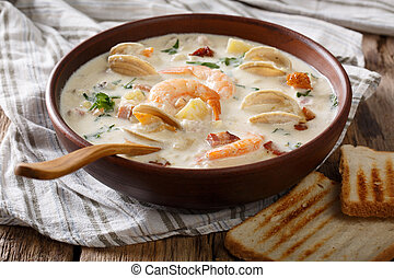 Thick milky Clam chowder soup close-up. horizontal - Thick...