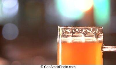 Thick orange beer head.