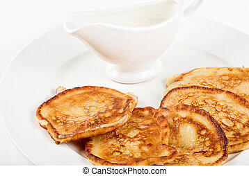 thick pancake closeup with sauce on a white