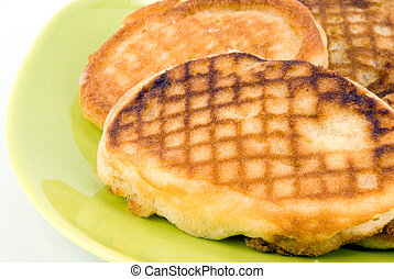thick pancake on green plate