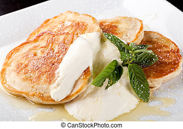 thick pancake with sour cream and syrup
