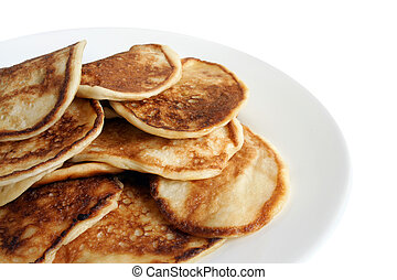 Thick pancakes on plate isolated on the white background