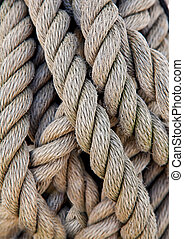 Thick ropes of a ship's rope