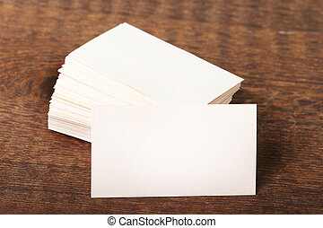 Thick white cotton paper business card mock up on vintage wooden deck