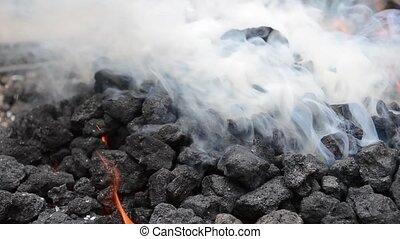 Thick White Smoke from Burning Coal - Burning coal smokes...