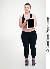 Thick woman showing blank tablet computer screen - Full...