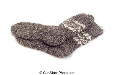 Thick wool hand-knitted socks on a white background