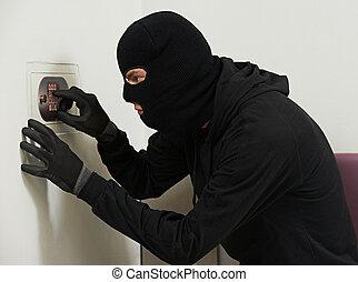thief burglar at house code breaking