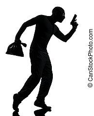 thief criminal holding gun
