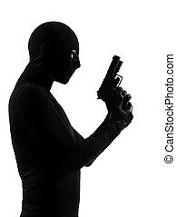 thief criminal terrorist holding gun portrait