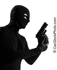 thief criminal terrorist holding gun portrait silhouette
