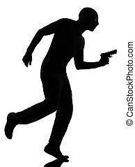 thief criminal terrorist in silhouette studio isolated on...