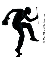 thief criminal walking quiet in silhouette studio isolated...