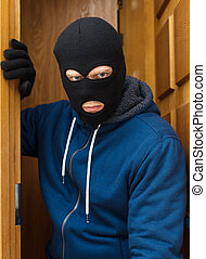 Thief entering the private property.